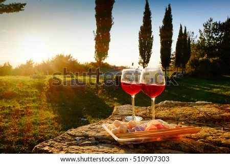 Landscape of Tuscany and two glasses of wine