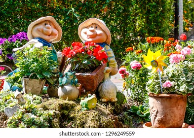 Landscape with two funny garden gnomes among colorful flowerpots in the Spreewald Biosphere Reserve, moorland and fairytale idyll. Brandenburg, near Berlin, Germany