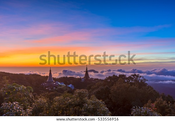 Landscape of two pagoda (noppha methanidon-noppha phon phum siri stupa) in sunrise time with mist in the backgroundat at Inthanon mountain, chiang mai, Thailand