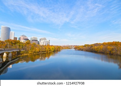 Landscape of US capital city in autumn. A view on Georgetown and Arlington neighborhoods divided by Potomac River, Washington DC, USA.