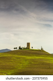 A landscape of the Val D'Orcia in Tuscany with one of the many ancient towers in this area.