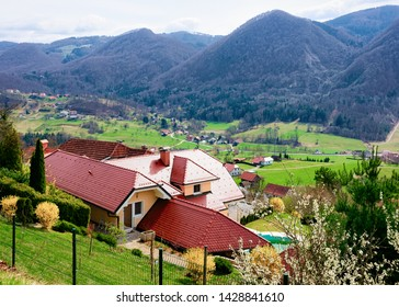 Landscape of valley and Celje old town in Slovenia. Architecture at the green hill in Slovenija. Alps mountains on the background.