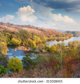 Landscape - Valley of River in Autumn, beautiful sunny day, colorful trees and clouds