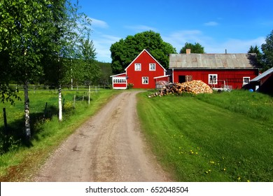 Landscape of Varmland with a path leading to a red house, Sweden