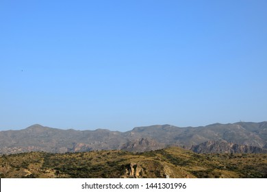 Landscape view across distant 'wild west' mountains in sunny Spain