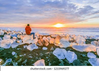 Landscape View Of The Amazing Jokulsarlon Beach (Diamond Beach) With Giant Ice Rocks On The Lava Black Beach, Shine Like Crystal Diamond Under Sunrise, Glacier Lagoon Jokulsarlon, Iceland