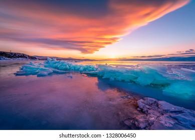 Landscape view of Baikal lake in winter season with colorful sunset sky background, Shamanka cape, Burkhan island Olkhon at Baikal lake, Russia