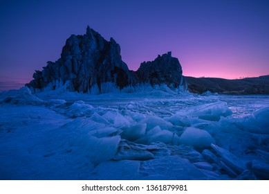 Landscape view of Baikal lake winter with colorful sunset sky background, Shamanka cape, Burkhan island Olkhon at Baikal lake, Russia