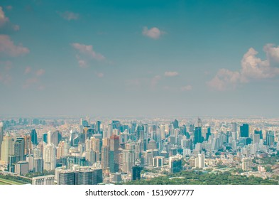 Landscape view of Bangkok city and business urban downtown with blue sky , Cityscape capital and financial district center of Bangkok, Thailand