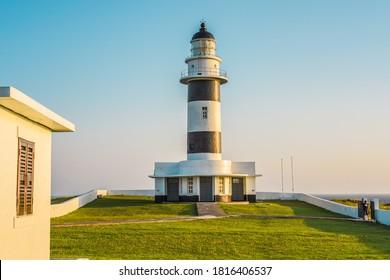 Landscape View Of The Beautiful Dongjiyu (Dongji) Lighthouse With GreenGrass By the Sea After Sunrise, The South Penghu Marine National Park, Wangan, Penghu, Taiwan