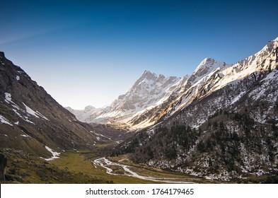 Landscape view of beautiful Har ki doon valley. Swargarohini peak and glacier Elevation: 6,252 m (20,512 ft)
