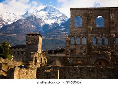 Landscape view of beautiful mountains landscape in Valle d'Aosta. Teatro Romano â?? Aosta, Valle d'Aosta, Italy