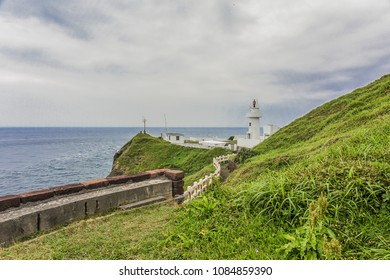 Landscape View of A Beautiful White Lighthouse (Bitou Lighthouse) at The Northeast Coast of Taiwan, New Taipei City, Taiwan
