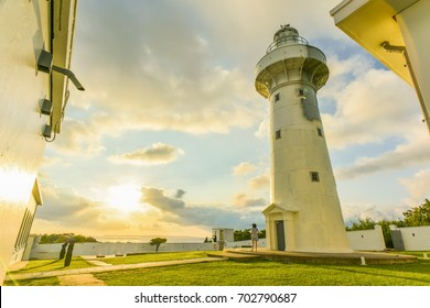 Landscape View of A Beautiful White Lighthouse (Eluanbi Lighthouse) at The Most South Coast of Taiwan at Sunset,
