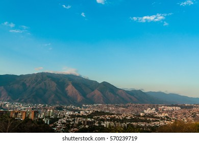 Landscape view of caracas at sunset with avila mountain in background with clear blue sky