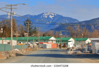 Landscape view of commercial and industrial zoning with snow capped mountains in the background.