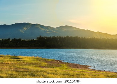 Landscape view of country side of CHIANGMAI THAILAND . Mountain lake and land in evening scene