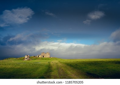 Landscape view of countryside with ruins of abandoned building, Iceland, Europe