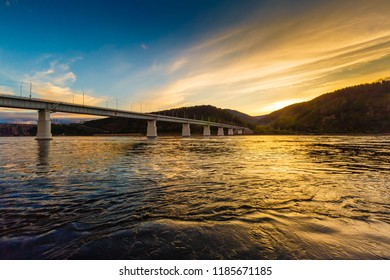 Landscape a view of a dam a hydra of power plant on the Yenisei River in Russia, sunset