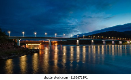 Landscape a view of a dam a hydra of power plant on the Yenisei River in Russia, twilight, lamps