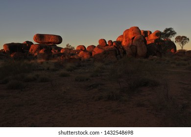 Landscape view of Devils Marbles Karlu Karlu at sunset in the Northern Territory, Australia