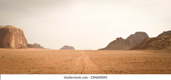 Landscape view of dusty road going far away nowhere in Wadi Rum desert, Jordan