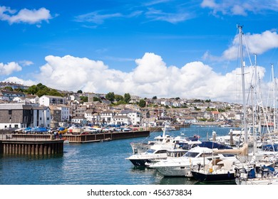 Landscape view of Falmouth in Cornwall UK including view of boats marina harbor and town on a brilliant blue sky day from afar. Travel concept. Cornish vista. Cornwall tourism,
