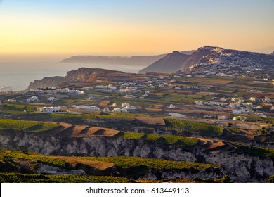 Landscape view of fields, vineyards and greek villages Fira and Oia on Santorini island, Greece
