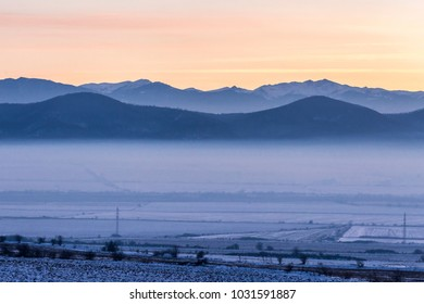 Landscape view of a foggy sunset on Rhodophe mountain, Bulgaria