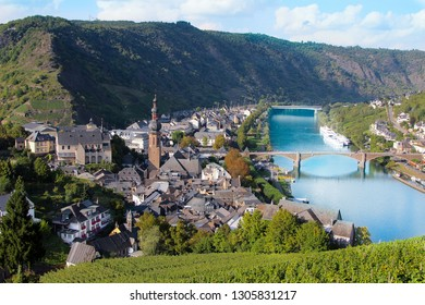 Landscape view of Germany pictorial Cochem town with romantic Rhein river,  medieval bridge and mountains background. German city Cochem historical castle on the Moselle valley on sunny summer day
