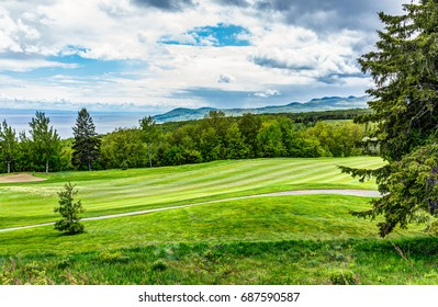 Landscape view of green golf course with hills in summer in La Malbaie, Quebec, Canada in Charlevoix region