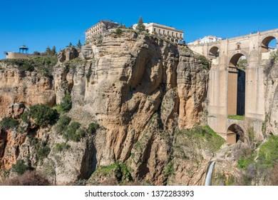 Landscape and view of the historic bridge, over the cliff of the city of Ronda, Andalusia, Spain