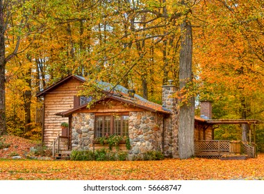 Landscape view of a home in the fall with all the colorful foliage