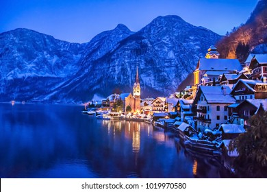 Landscape view of house on mountain with snow mountains as background. Beautiful Hallstatt lakeside town with the Alps in winter at Austria.