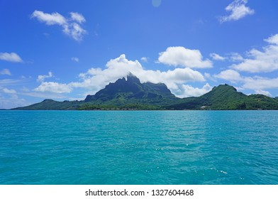 Landscape view of the island of Bora Bora in French Polynesia with the Mont Otemanu mountain surrounded by a turquoise lagoon