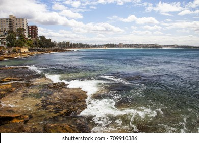 A landscape view of Manly Beach, Sydney, Australia, taken from the Fairy Bower Baths.
