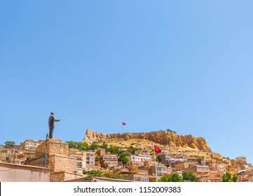 Landscape view of Mardin old city and Mardin Castle with Ataturk statue on foreground in Mardin,Turkey.17 June 2018