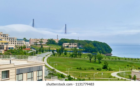 Landscape view of mist over famous bridge to the campus of far east university from Vladivostok