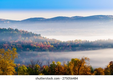Landscape view of a morning sunrise during fall foliage season, Stowe, Vermont, USA.