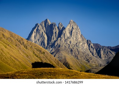 Landscape view of mountain peaks and meadows in Kazbegi national park, Country of Georgia