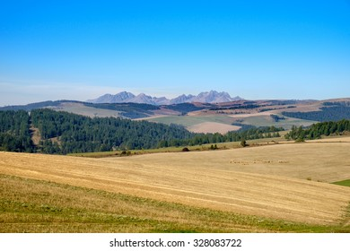 Landscape view of mountain range and autumn colorful hills, fields, meadows and foliage, High Tatras, Slovakia