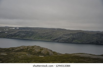 Landscape view of mountain and sea at Magerøya island in Finnmark county on the way to North Cape (Nordkapp) at midnight time in Norway