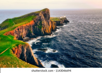 Landscape view of Neist point lighthouse and ocean coastline, Isle of Skye, Scottland, UK