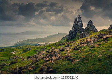 Landscape view of Old Man of Storr rock formation, dramatic cloudy day, Scotland, United Kingdom