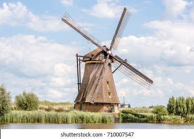 Landscape view on the old windmill in Kinderdijk village in Netherlands