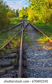 Landscape view on the rails of the old railroad in the fall