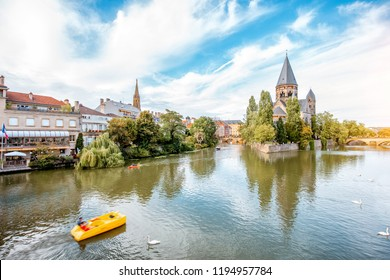Landscape view on the riverside with Neuf basilica in Metz city in Lorraine region of France