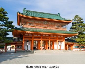 Landscape view of orange colored Heian Jingu shinto shrine's main gate in Kyoto, Japan. The Heian Jingu hosts the Jidai Matsuri, one of the three most important festivals of Kyoto.