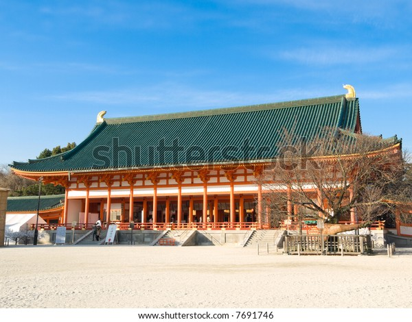 Landscape view of orange colored main building of Heian Jingu shinto shrine in Kyoto, Japan. Heian Jingu hosts the Jidai Matsuri, one of the three most important festivals in Kyoto.