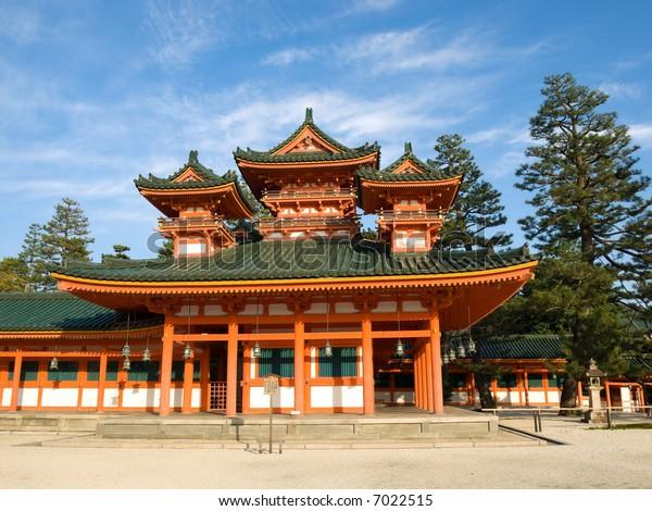 Landscape view of orange coloured Heian Jingu shinto shrine in Kyoto, Japan. The Heian Jingu hosts the Jidai Matsuri, one of the three most important festivals of Kyoto.